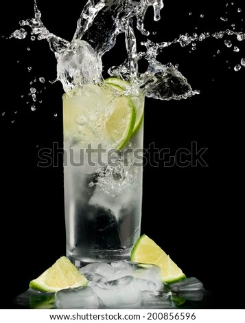Gin tonic cocktail splash - stock photo