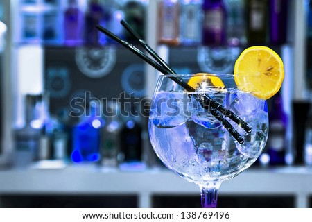 Gin Tonic Cocktail with slice of lemon - stock photo