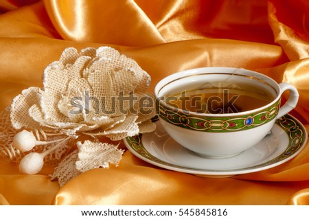 ginger and orange tea on a golden fabric
