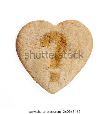 Ginger biscuits in the shape of a heart with a question mark: , isolated - stock photo