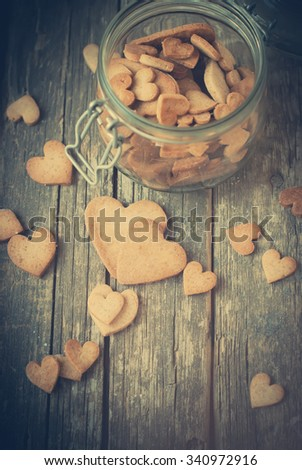 Ginger Cookies in the Shape of Hearts on Wooden Table. Toned Image. Valentines theme