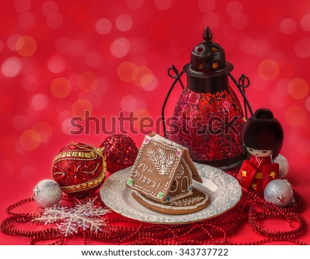 Ginger gingerbread house with a wish of happiness in Japanese and  Christmas decor next to the doll Kokeshi (mass production) - stock photo