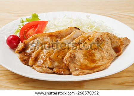 ginger glow of the pork of a Japanese-style dish