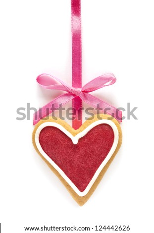 Ginger Heart shaped cookie for Valentine's or Wedding Day with pink ribbon. Isolated on white background - stock photo
