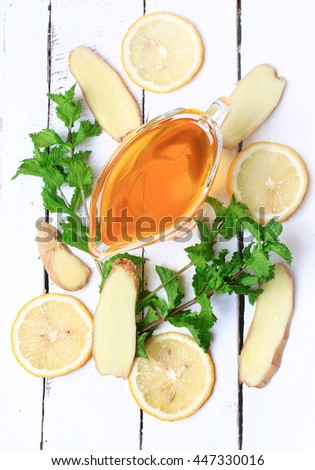 ginger honey lemon mint on a white wooden background ingredient for homemade lemonade rustic style flat look view from above over head - stock photo