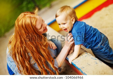 Ginger mother with baby - stock photo