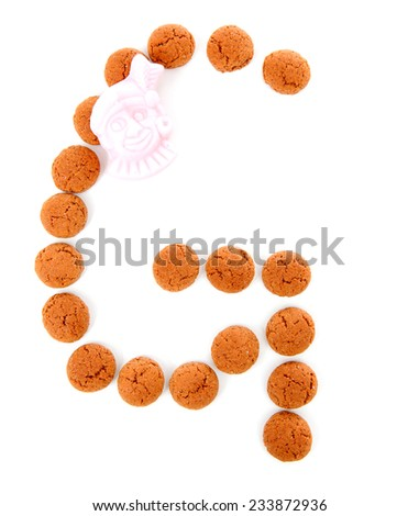 Ginger nuts, pepernoten, in the shape of letter G isolated on white background. Typical Dutch candy for Sinterklaas event in december - stock photo