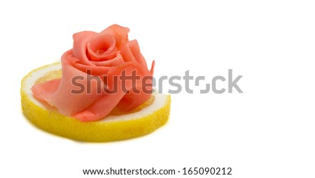 Ginger on lemon isolated on white background