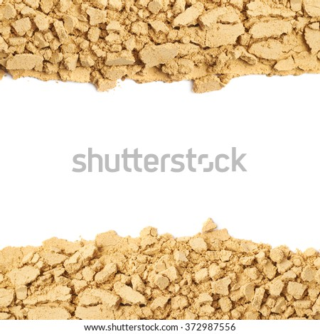 Ginger powder background composition - stock photo
