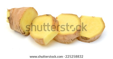 Ginger root with slices isolated on white