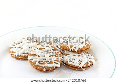 Ginger snaps filled with milk chocolate and topped with white chocolate frosting. - stock photo