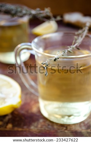 ginger tea with lemon and dry thyme - stock photo