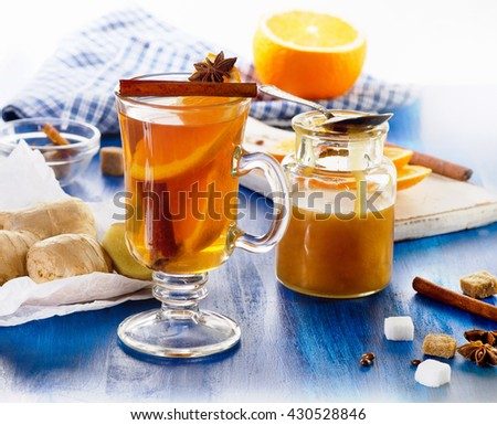 Ginger tea with orange and honey. Selective focus