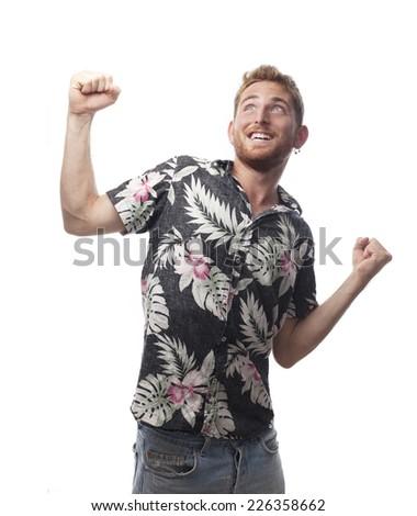ginger young man with hawaiian shirt celebrating something - stock photo