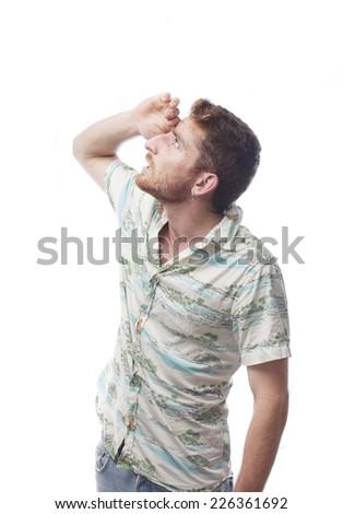 ginger young man with hawaiian shirt looking away - stock photo