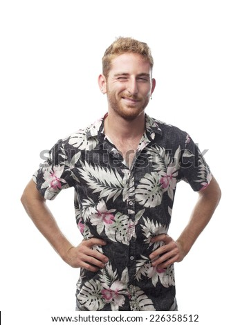 ginger young man with hawaiian shirt winking the eye - stock photo