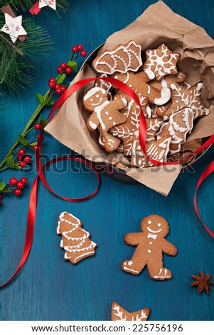 Gingerbread Christmas Cookies With Christmas Decoration Around - stock photo