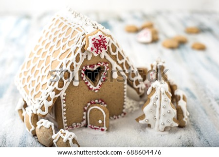 Gingerbread Christmas house, decorated with sugar icing