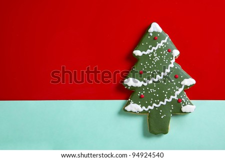 Gingerbread Christmas tree on red background - stock photo