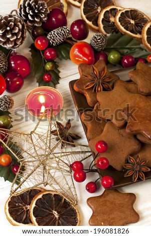 Gingerbread cookie and Christmas decorations on a table