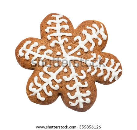 Gingerbread cookie made in the shape of a Christmas star (snowflake) isolated on the white
