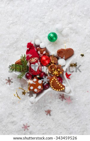 Gingerbread cookies and candy in Christmas setting, selective focus - stock photo
