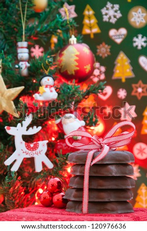 Gingerbread cookies and christmas tree - stock photo