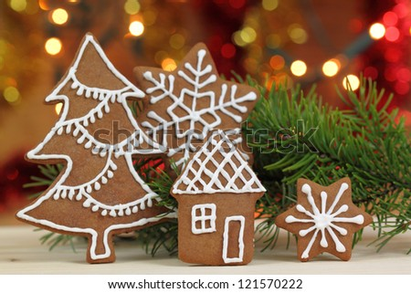 Gingerbread cookies and colored lights. Christmas decoration. - stock photo