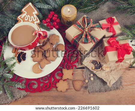 Gingerbread cookies and cup of coffee with christmas decoration - stock photo