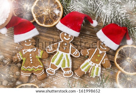 Gingerbread cookies and spices on wood plank  - stock photo