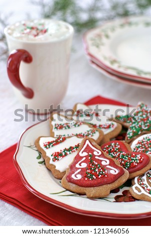 Gingerbread cookies decorated for Christmas with icing and sprinkles. - stock photo