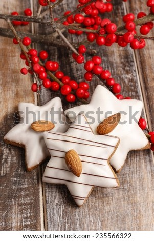 Gingerbread cookies in star shape decorated with almonds - stock photo