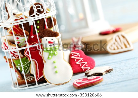 Gingerbread cookies on a blue wooden table - stock photo