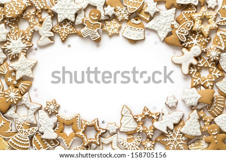 Gingerbread cookies on white background. Snowflake, star, man, angel, candy shapes. - stock photo