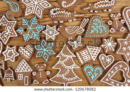 Gingerbread cookies on wooden background. Christmas decoration. - stock photo