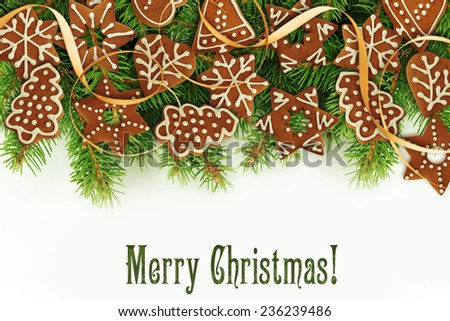 Gingerbread cookies over Christmas tree. - stock photo