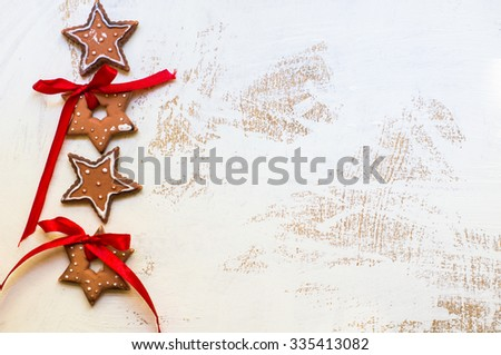 Gingerbread cookies star and heart  shaped  over wooden background - stock photo