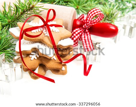 Gingerbread cookies with red decoration. Festive food background