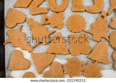 Gingerbread dough for Christmas cookies on a white background