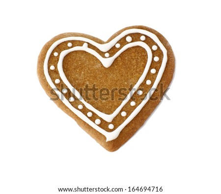 Gingerbread heart cookie decorated for Christmas on white background                - stock photo