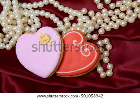 Gingerbread heart cookies on a red background