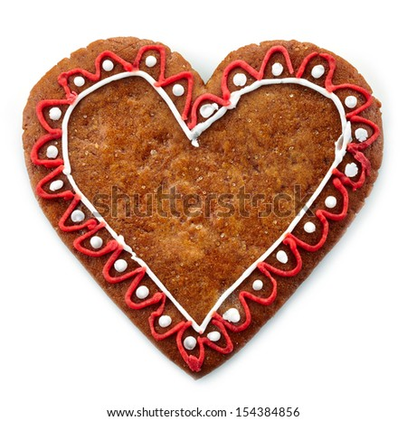 Gingerbread heart on white background - stock photo