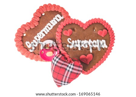 gingerbread Heart with the german words Super Mom and Super Dad / Gingerbread Heart - stock photo