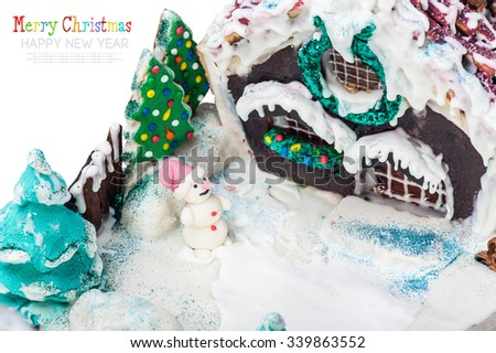 gingerbread house and candy for the holiday merry christmas isolated on white background. Focus on the snowman - stock photo