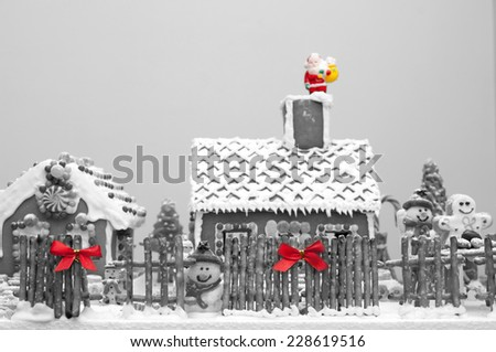 Gingerbread house Christmas decoration selective color applied - stock photo