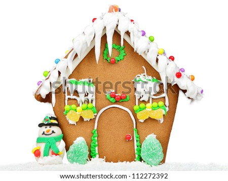 Gingerbread house isolated on white background in studio with Christmas tree and snowman. - stock photo
