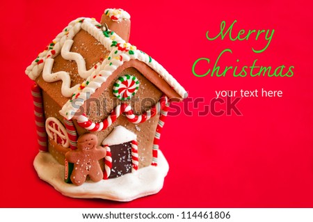 Gingerbread house on red background. - stock photo