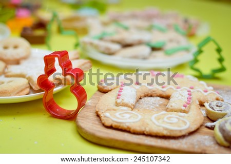 Gingerbread house on wooden desk and light green background - stock photo