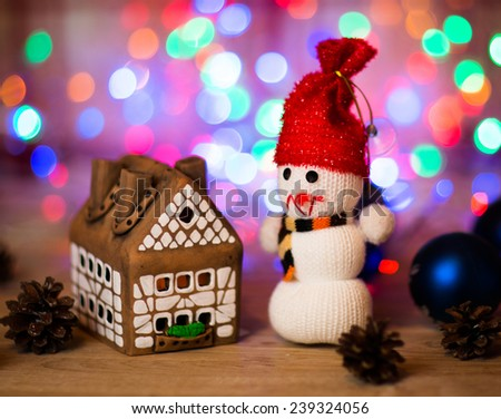 gingerbread house over  and lovely handmade snowman - stock photo