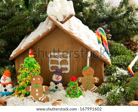 Gingerbread house with decorations, ginger biscuits. - stock photo